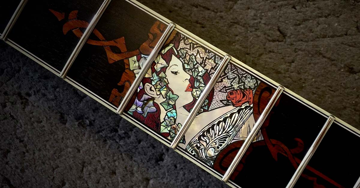 Guitar inlays example - fretboard inlay using abalone and wood inlays.